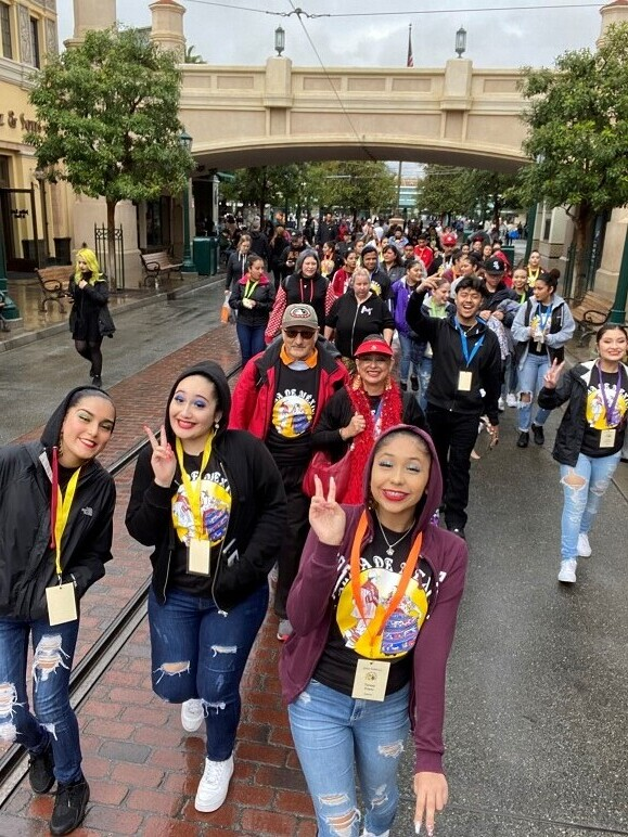 Folklorico group walking into California Adventure